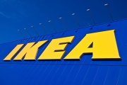 IKEA logo, yellow uppercase type for name IKEA, dark blue background