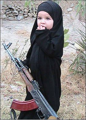 Very young girl with gun