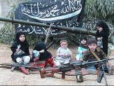 six young children with guns in foreground, al-Qaeda flag in background