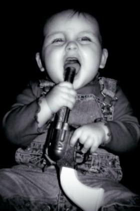 child with gun to his or her mouth