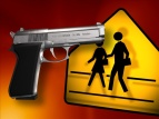 Pistol and yellow school crossing sign