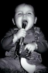 baby with gun in its mouth