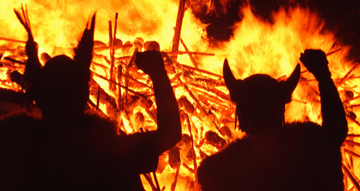 Anglo-Saxon-Jutes silhouetted against burning Celtic village