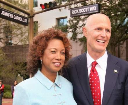Jennifer Carroll and Rick Scott