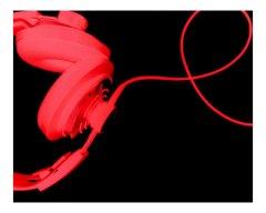 red headphones against black backdrop